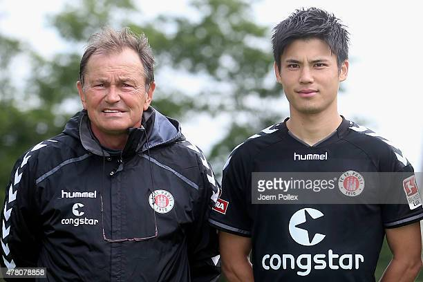 St Pauli Football Club's new signing Ryo Miyaichi and head coach Ewald Lienen pose for a photograph following his transfer on June 22 2015 in Hamburg...