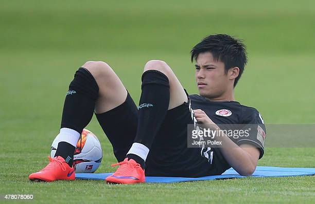 St Pauli Football Club's new signing Ryo Miyaichi warms up during a training session on June 22 2015 in Hamburg Germany
