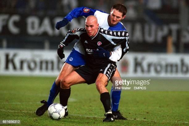 St Pauli's Marcel Rath shields the ball from Hertha Berlin's Pal Dardai