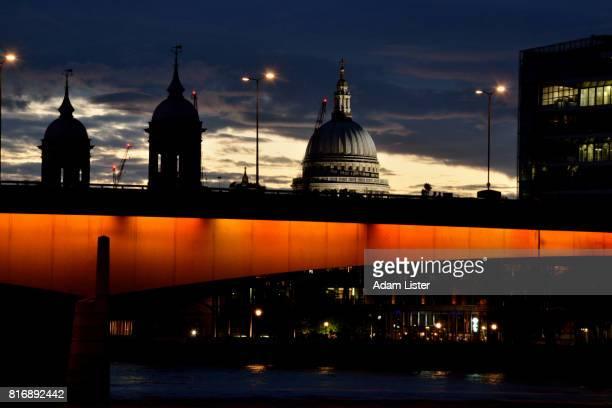 St Pauls at dusk over London bridge