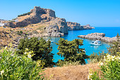 View of Acropolis and St Pauls harbour in Lindos. Rhodes, Greece