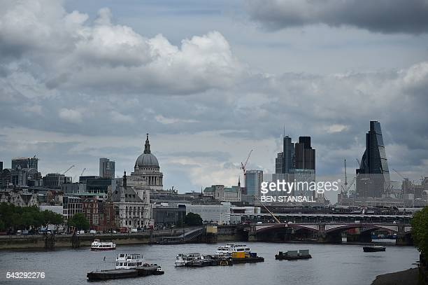 St Paul's Cathedral and buildings in City of London are seen under banks of cloud in central London on June 27 2016 Britain began preparations to...