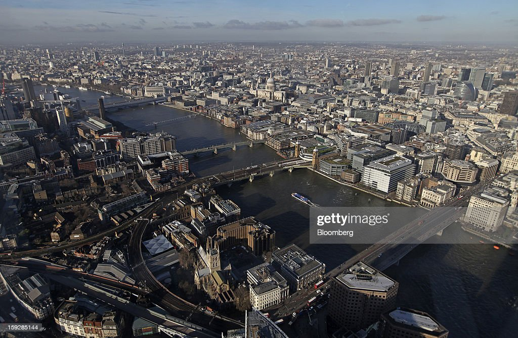 St. Paul's Cathedral, center, is seen beyond the River Thames from 'The View From The Shard', a series of viewing galleries near the top of the Shard tower in London, U.K., on Wednesday, Jan. 9, 2013. The Shard, which stands at 309.6 meters on London's South Bank, is owned by LBQ Ltd., which brings together the State of Qatar (the majority shareholder) and Sellar Property Group Ltd., with non-equity funding by Qatar National Bank. Photographer: Chris Ratcliffe/Bloomberg via Getty Images