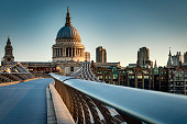 St Paul's cathedral dome and the rail from the Millennium bridge, early in the morning twilight in London, England, UK. Saint Paul Cathedral is an Anglican church