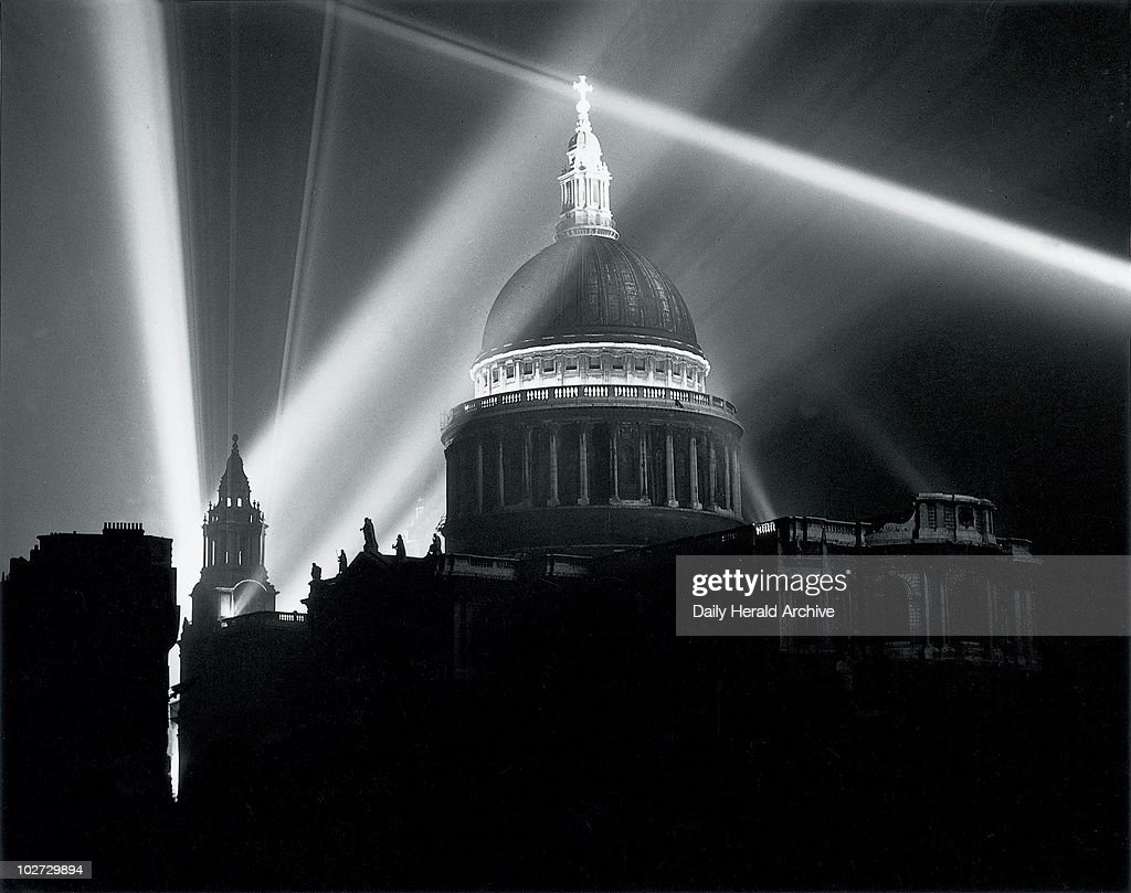 St Paul's Cathedral illuminated on the night of VE Day, London, 8 May 1945. Christopher Wren's cathedral lit up by beams of light to celebrate the end of World War II in Europe.