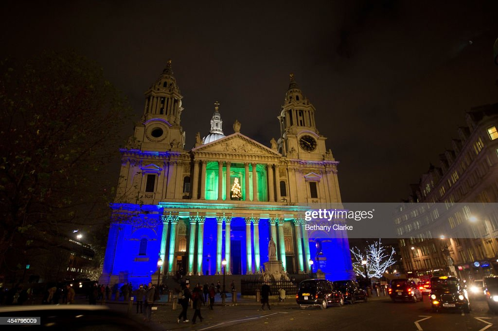 St Paul's Cathedral is lit up in blue and green to mark the Standard Chartered charity carol service on December 10, 2013 in London, England.