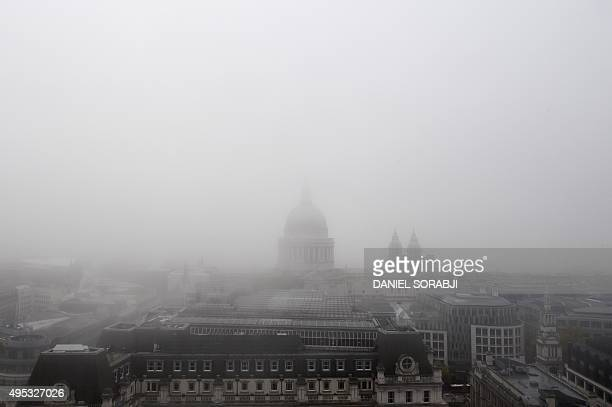 St Paul's Cathedral is seen through thick fog smothering London on November 2 2015 Thick fog over much of England and Wales has caused travel...