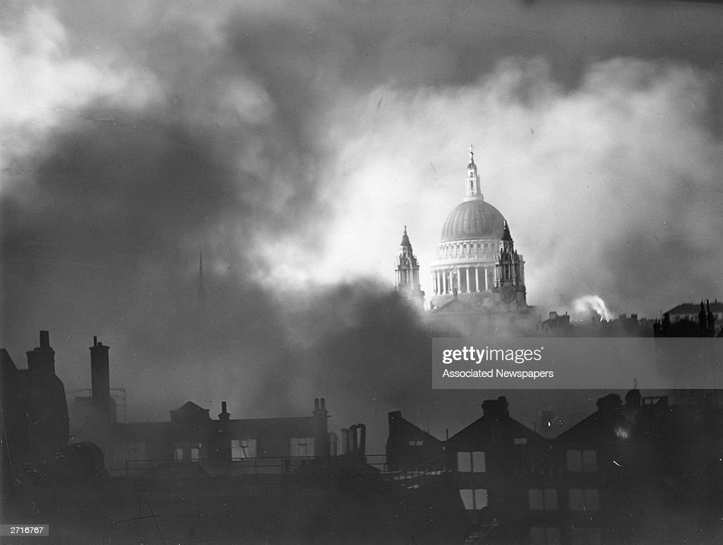 St Paul's cathedral standing above the surrounding burning buildings during the London blitz.