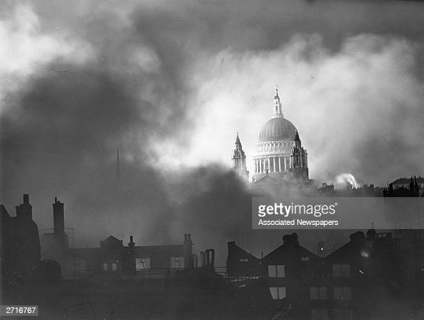 St Paul's cathedral standing above the surrounding burning buildings during the London blitz