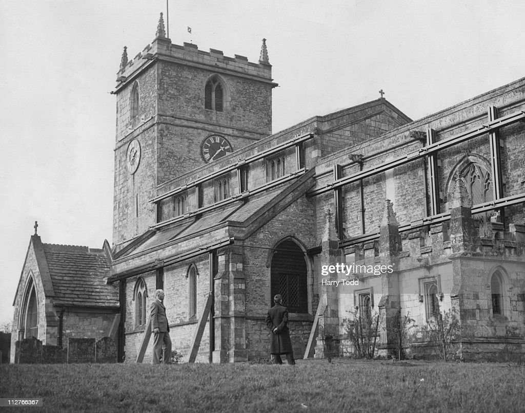 St. Peter and St. Paul's Church, Warsop, Nottinghamshire, 8th February 1934. The exterior of the church showing steel girders clamping walls and steel band round tower.