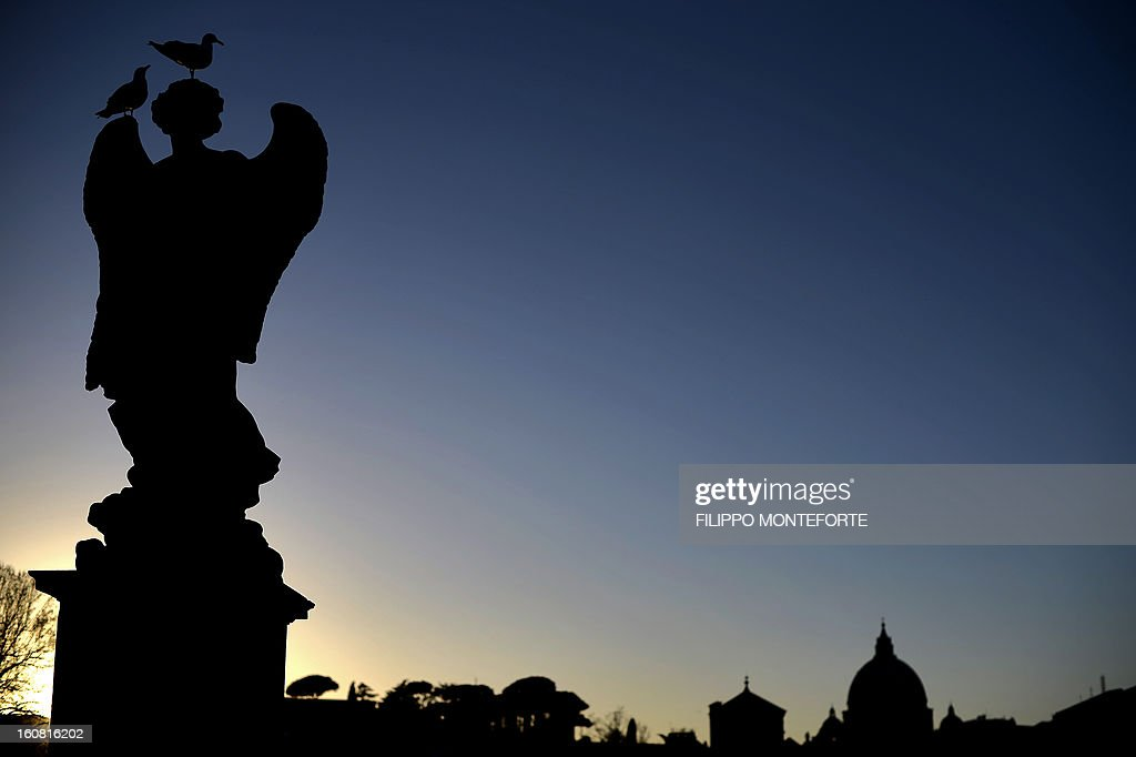 St Peter Basilica's dome is seen by the statue of an angel on Rome's Castel Sant'Angelo bridge on February 6, 2013 where the exhibition 'Peter's Journey' is taking place. The exhibit, opened until May 1, 2013, is one of the initiatives of the Pope Benedict XVI's Year of Faith (October 11, 2012-November 24, 2013) Year of Faith, a collaborative effort between nine countries that will include pieces ranging from the 4th and 5th centuries all the way to the beginning of the 20th.
