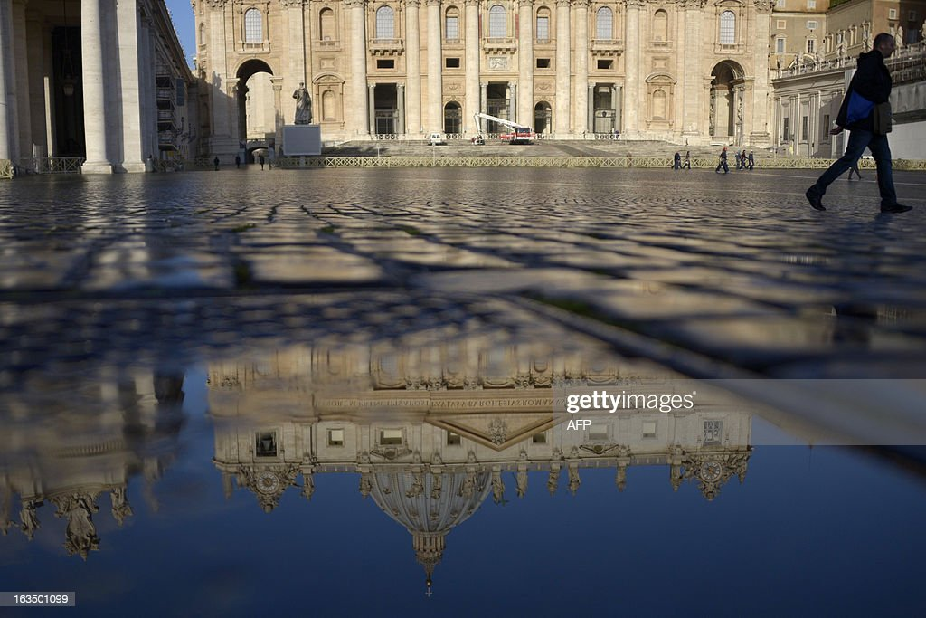 St Peter's basilica is reflected in a puddle on St Peter's square on March 11, 2013 at the Vatican. Cardinals will hold a final set of meetings the same day before they are locked away to choose a new pope to lead the Roman Catholic Church through troubled times.