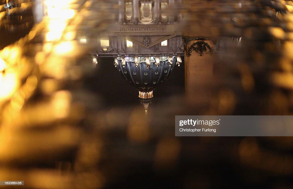 St. Peter's Basilica is reflected in a rain puddle as the Vatican prepares for a new pope on March 8, 2013 in Vatican City, Vatican. Cardinals are set to enter the conclave to elect a successor to Pope Benedict XVI after he became the first pope in 600 years to resign from the role. The conclave is scheduled to start on March 12 inside the Sistine Chapel and will be attended by 115 cardinals as they vote to select the 266th Pope of the Catholic Church.