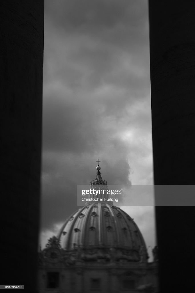 St Peter's Basilica is seen trhough the pillars of the colonnade on March 15, 2013 in Vatican City, Vatican. Daily life continues around the vatican as romans prepare for the inauguration mass of Pope Francis, the first ever Latin American Pontiff.