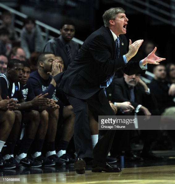 St Peter's head coach John Dunne tries to motivate his team during the second half against Purdue in the second round of the 2011 NCAA Men's...