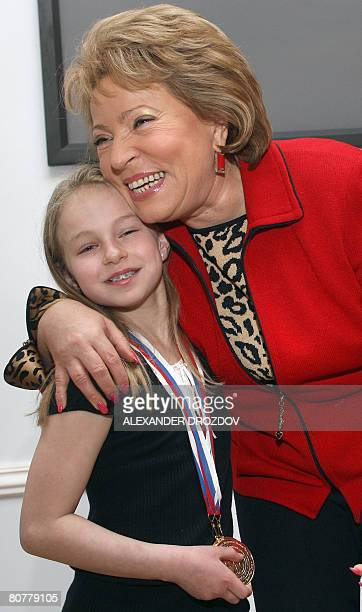St Petersburg Governor Valentina Matviyenko hugs US karate fighter Samantha Smith from Pennsylvania in St Petersburg on April 19 2008 during a...