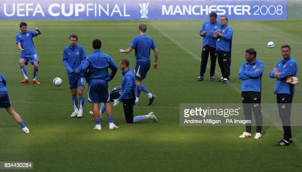 St Petersburg manager Dick Advocaat watches his players during a training session at City Of Manchester Stadium Manchester