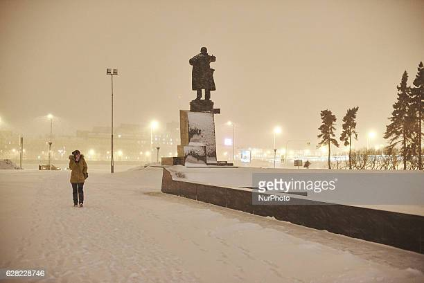 St Petersburg Russia A woman pass the monument of 1917 Revolution leader Vladimir Lenin at the square of his name Behind there is building of Finland...