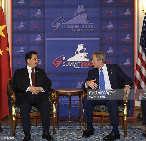 US President George W Bush speaks during a bilateral meeting with Chinese President Hu Jintao 16 July 2006 on the sidelines of the G8 Summit in...