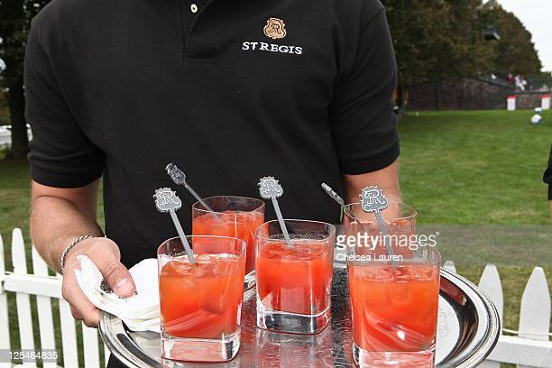 St Regis servers pass out the St Regis' signature Bloody Mary at the St Regis 1904 Polo Cup at Greenwich Polo Club on September 17 2011 in Greenwich...
