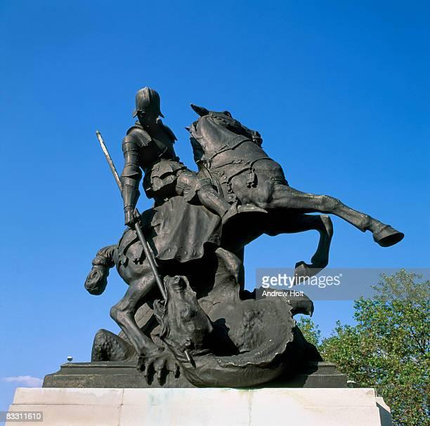 St Saint George on horse slaying dragon statue