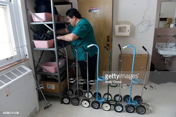 St Vincent Hospital respiratory therapist Sol Jiron organizes regulators for oxygen tanks Tuesday morning November 25 2014 St Vincent is...