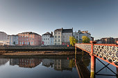 View of St Vincent's Footbridge and surrounding buildings in Cork City, Ireland