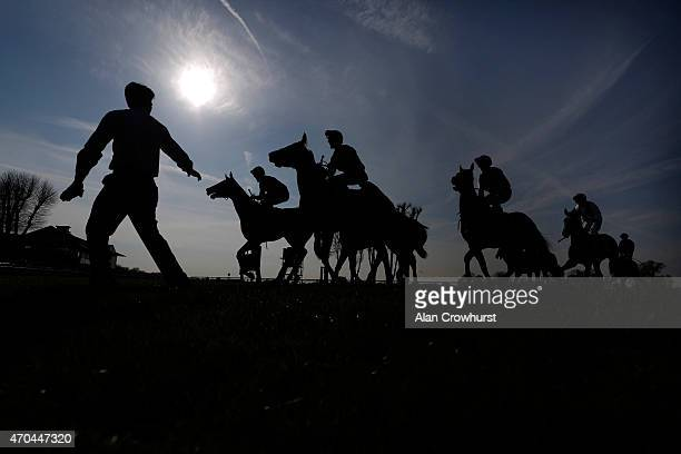 A stable lad waits for his runner to return after finishing at Windsor racecourse on April 20 2015 in Windsor England