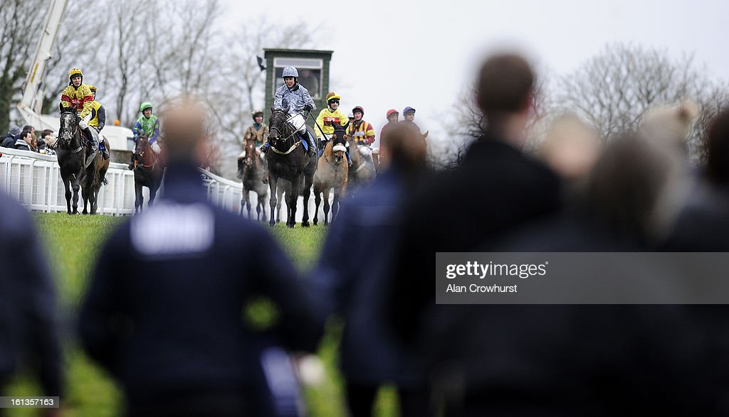 Stable lads await the return of their horses at Exeter racecourse on February 10, 2013 in Exeter, England.
