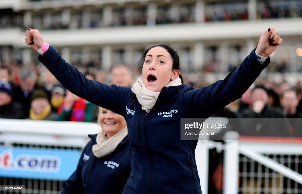 A stable lass who works for trainer Gordon Elliot cheers home her horse during Ladies Day at Cheltenham racecourse on March 13, 2013 in Cheltenham, England.