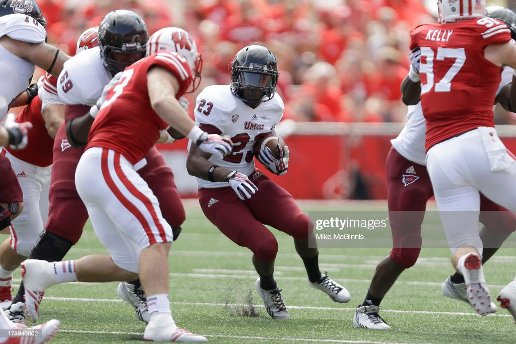 Stacey Bedell #23 of the UMass Minutemen finds a whole and run upfield during the game against the Wisconsin Badgers at Camp Randall Stadium on August 31, 2013 in Madison, Wisconsin.