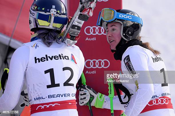 Stacey Cook of the United States speaks with Laurenne Ross of the United States after their runs during the women's downhill training FIS Alpine...