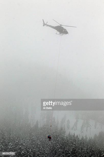 Stacey Cook of United States is airlifted off the slope by helicopter during the Ladies Downhill training run at Whistler Creekside ahead of the...