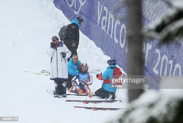 Stacey Cook of United States receives medical attention shortly before being airlifted off the slope by helicopter during the Ladies Downhill...
