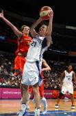 Stacey DalesSchuman of the Washington Mystics shoots against Anna DeForge of the Phoenix Mercury during the WNBA game at MCI Center on August 3 2003...