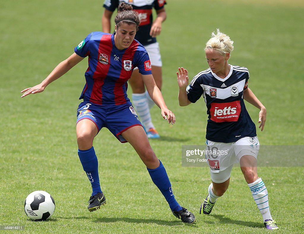 Stacey Day of the Jets contests the ball against Jessica Fishlock of the Victory during the round 10 W-League match between the Newcastle Jets and Melbourne Victory at Adamstown Oval on January 25, 2014 in Newcastle, Australia.