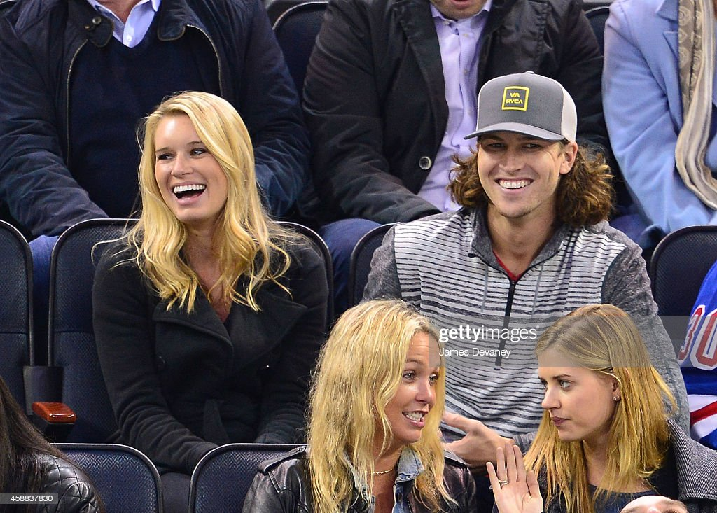Stacey Harris and Jacob deGrom attend the Pittsburgh Penguins Vs New York Rangers game at Madison Square Garden on November 11 2014 in New York City