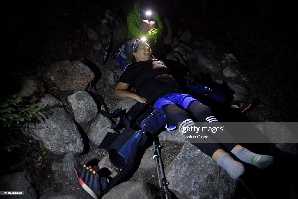 Stacey Kozel, 41, winces in pain while resting on the Chimney Pond Trail in Baxter State Park, Maine at 11 p.m. on Aug. 26, 2016. The hiking is extremely slow in the darkness, and Staceys right brace had lost its charge and locked up. Now she would be hiking stiff legged with both braces. Stacey says she has to stop for a couple hours. She says her legs are swollen and she needs to take her braces off for a couple hours to get her blood circulating. This is one of my worst days. She says when her legs swell up like this she feels like she has to pry the braces off. Diagnosed with Lupus at 19, Kozel has been hospitalized countless times with her last flare-up leaving her paralyzed in March 2014. She worked relentlessly at her rehabilitation and regained partial use of her arms and upper core. But her legs remained completely paralyzed. Then, she discovered the Ottobock C-Brace. The braces uses sensors and microprocessors the braces to allow Kozel to achieve a natural gate. She has hiked more than two-thirds of the Appalachian Trail. The climb towards the summit of Mount Katahdin in Baxter State Park in Maine, and the northern terminus of the Appalachian Trail, is one part of her journey to hike the whole trail.