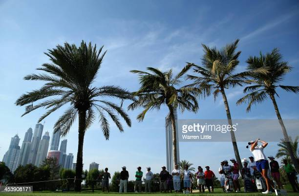 Stacey Lewis of the USA tees off on the ninth hole during the third round of the 2013 Omega Dubai Ladies Masters on the Majilis Course at the...