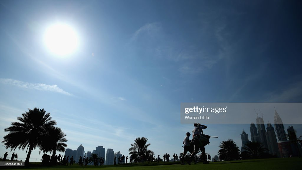 Stacey Lewis of the USA walks with her caddie during the third round of the 2013 Omega Dubai Ladies Masters on the Majilis Course at the Emirates...