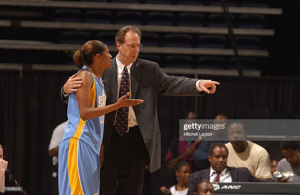 Stacey Lovelace #32 of the Chicago Sky with head coach Dave Cowens during a game against the Washington Mystics in a WNBA game on July 27, 2006 at the Verizon Center in Washington, DC.