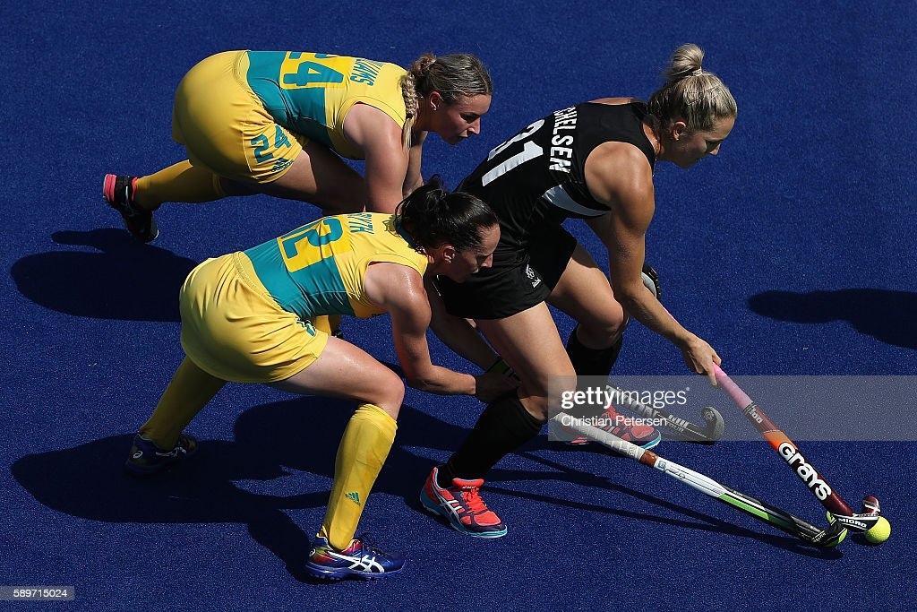 Stacey Michelsen of New Zealand attempts to control the ball pressured by Mariah Williams and Madonna Blyth of Australia during the second half of...