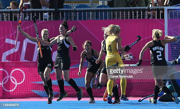 Stacey Michelsen of New Zealand celebrates scoring the opening goal with her team mates during the Women's Pool WB Match W01 between New Zealand and...