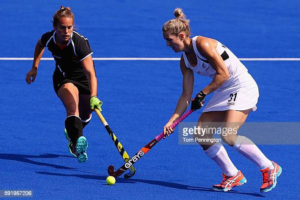 Stacey Michelsen of New Zealand controls the ball against Lisa Altenburg of Germany in the Women's Bronze Medal Match on Day 14 of the Rio 2016...