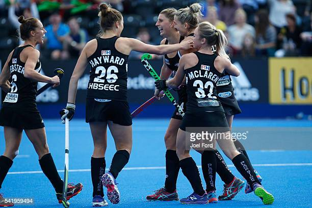 Stacey Michelsen of New Zealand is congratulated by teammates after scoring during the FIH Women's Hockey Champions Trophy 2016 match between Great...