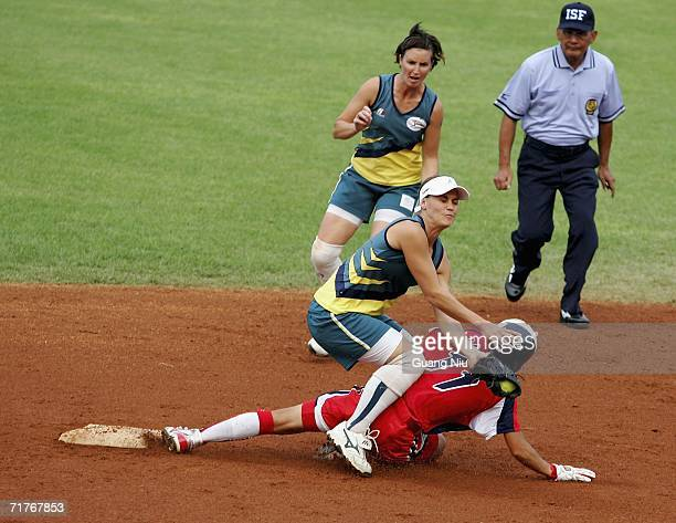 Stacey Porter of Australia holds a ball to touch Eri Yamada of Japan at the seocnd base during ISF XI Women's Fast Pitch Softball World Championship...