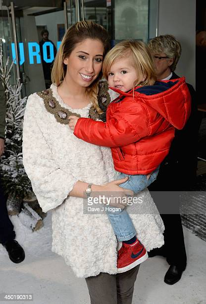 Stacey Solomon with her son Leighton attend Disney's 'Frozen' celebrity screening at the Odeon Leicester Square on November 17 2013 in London England