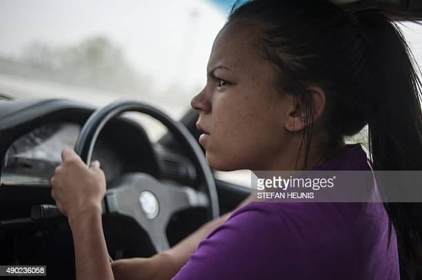 StaceyLee May drives her car during a round of spinning at the Midway spinning event in Soweto on September 12 2015 May is one of South Africas best...