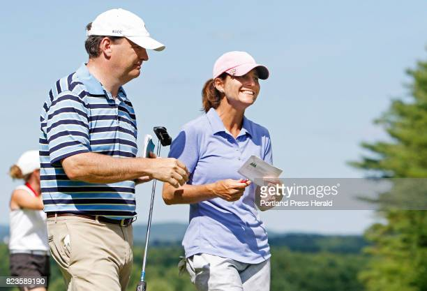 Staci Creech smiles as she and her husband Karlton Creech exit the 18th green following Stacis first place win in the Maine Women's Amateur golf...