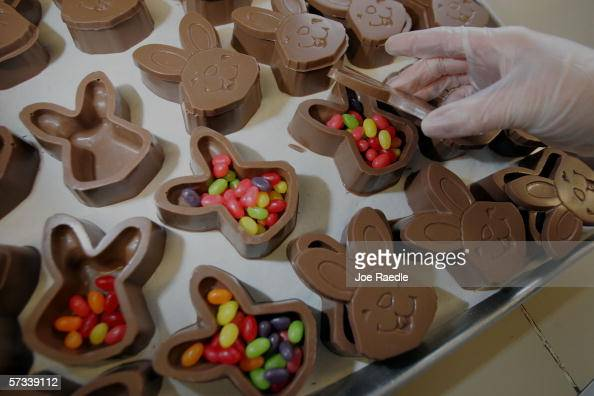 Stacie Gibson puts jelly beans inside chocolate Easter bunnies while making them at Phillips Candy House April 14 2006 in Dorchester Massachusetts...